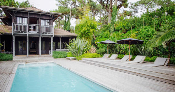 villa-architecte-9-pieces-superbe-salon-cheminee-jardin-tropical-a-vendre-cap-ferret