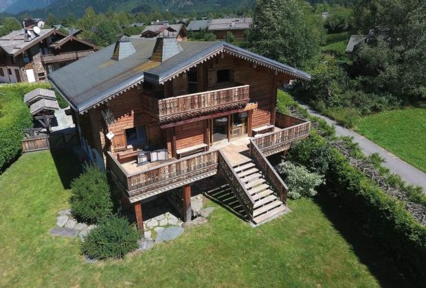 beautiful-traditional-chalet-for-sale-laundry-room-fireplace-terrace-parking