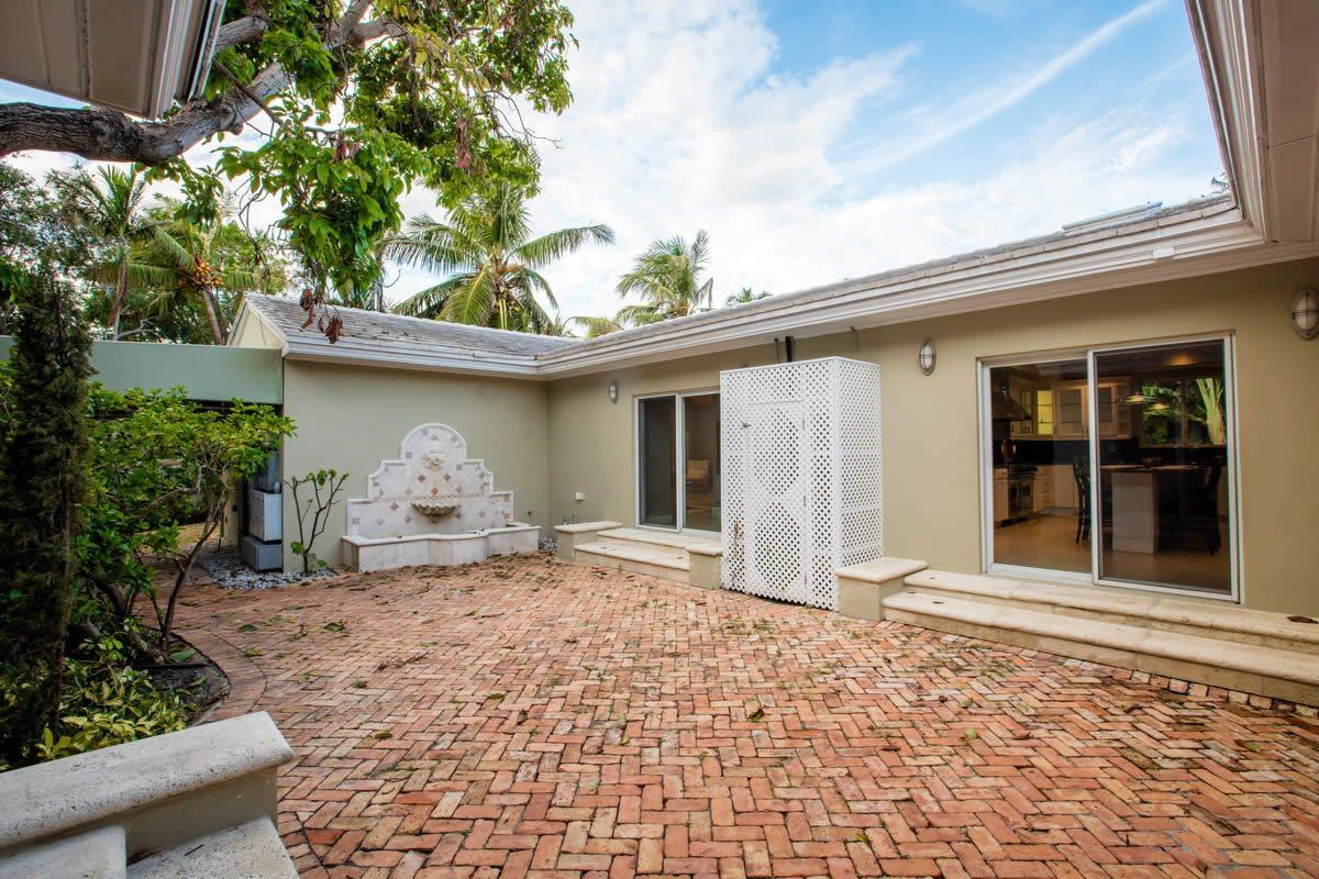 exceptionally-renovated-house-gated-community-for-sale-patio-bay-point-gym-heated-pool-garage