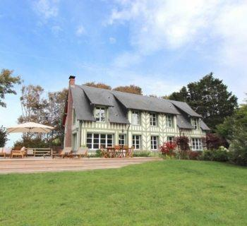 beautiful-norman-beachfront-villa-for-rent-benerville-sur-mer-fireplace-vast-terrace-tennis-court