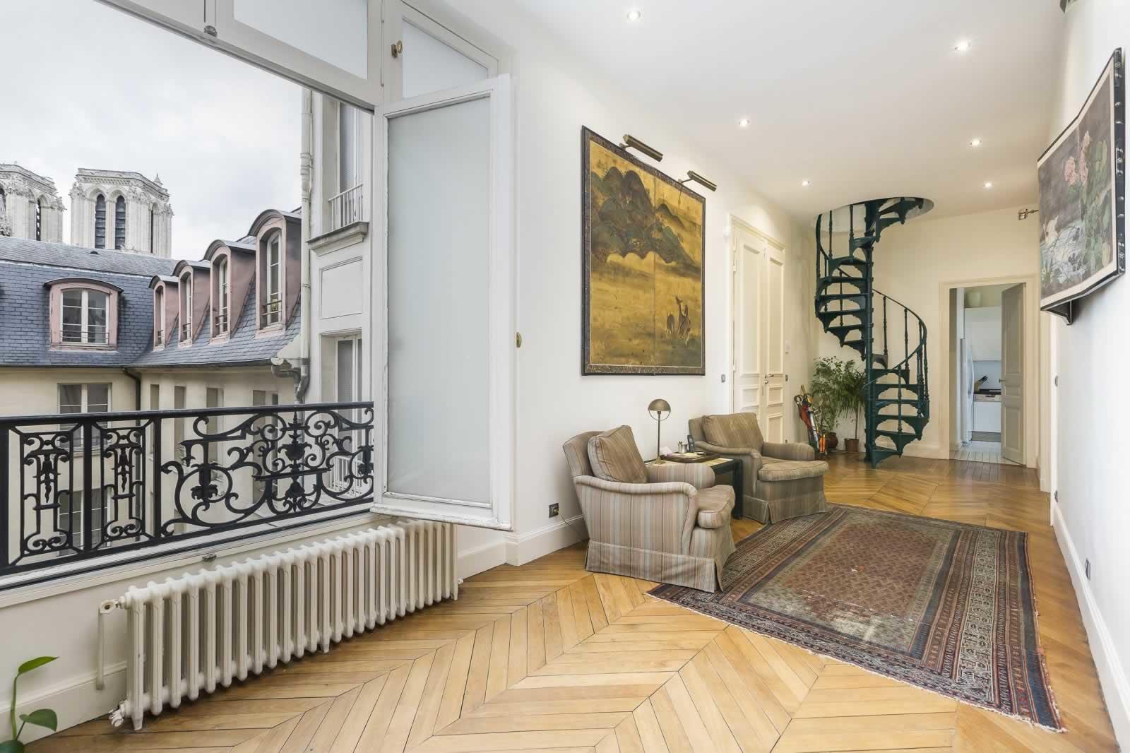 appartement-exceptionnel-a-vendre-gardien-ascenseur-cheminee-caves