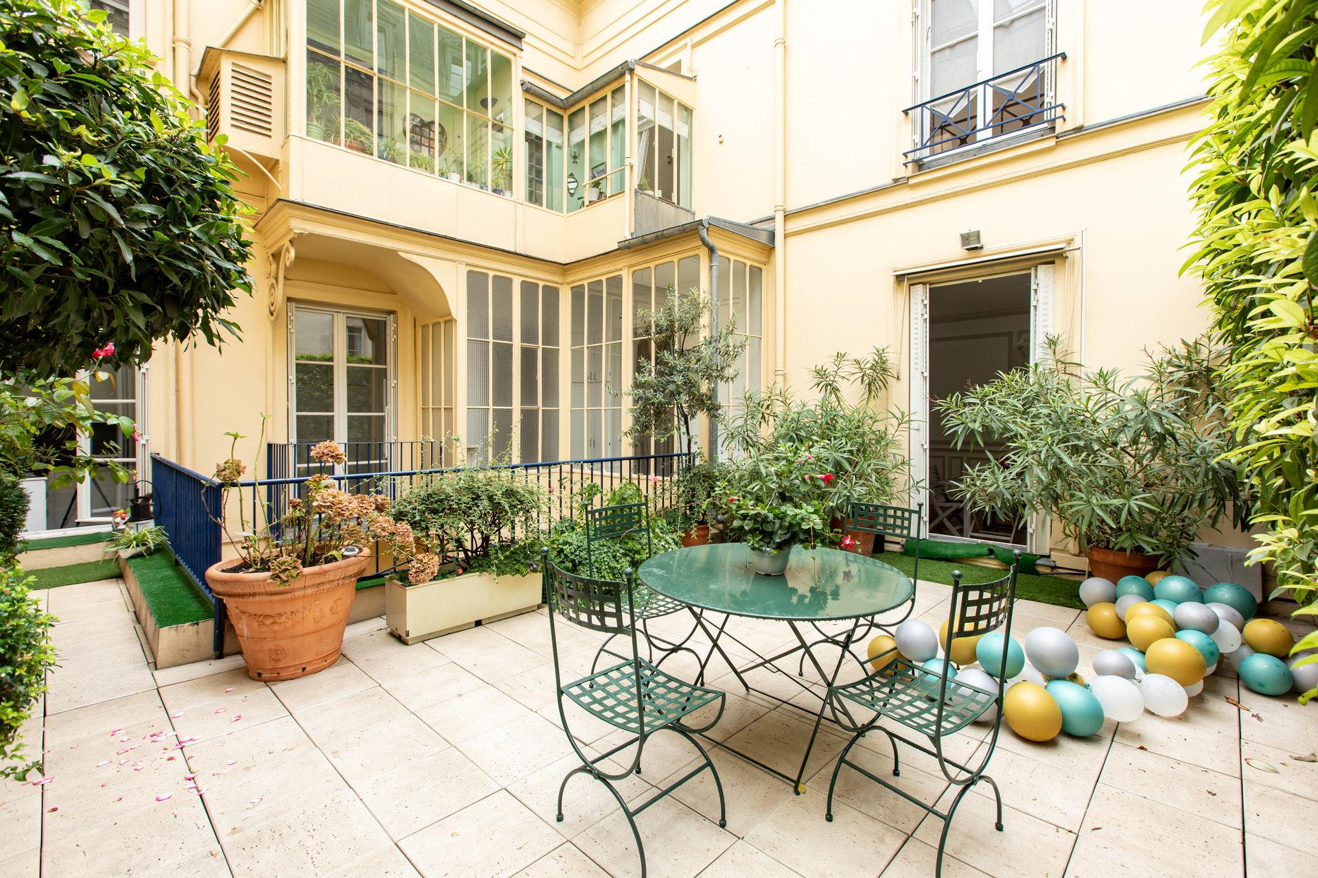 appartement-exception-1er-arrondissement-paris-terrasse-hauteur-sous-plafond-caves