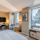 studio-luxe-a-vendre-immeuble-standing-dominick-soho-manhattan-entierement-meuble-baies-vitrees-vue-imprenable